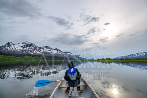 Boy Canoes in Robe Lake